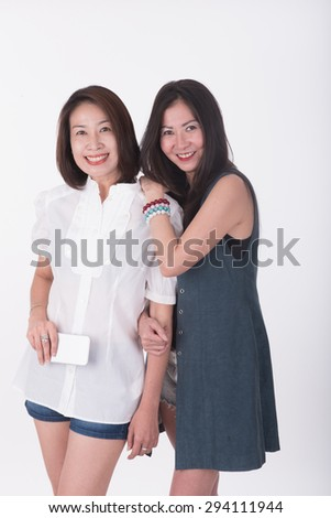 Two Asian female friends - stock photo