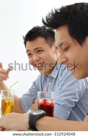 Two Asian men sharing a joke - stock photo