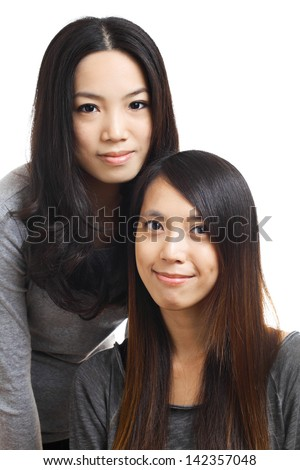 Two asian woman friends - stock photo
