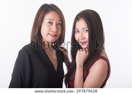 two asian woman standing