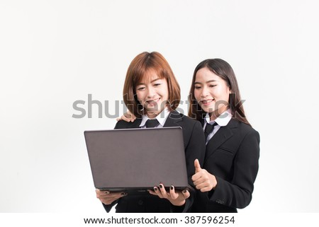 Two Asian women using laptop, isolate on white background.