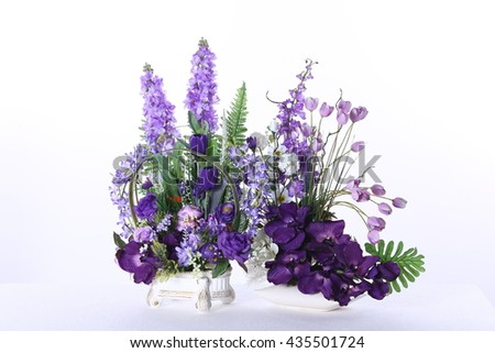 Two Assorted Artificial Flower Bouquet in Purple Color and kind of flowers in Studio Lighting on White Background