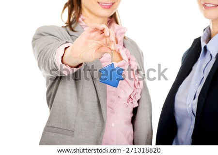 Two attractive architects women with house key. - stock photo