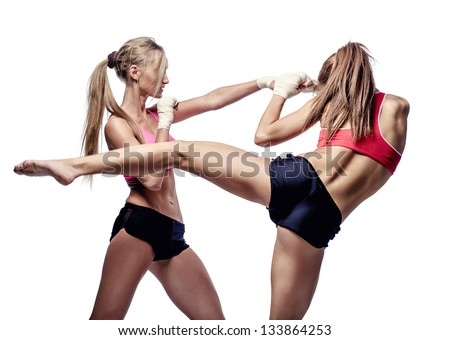 Two attractive athletic girls fighting, isolated on  white background