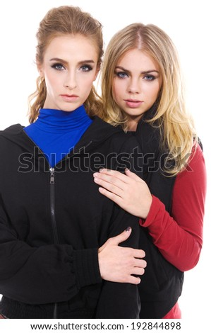 Two attractive blond girl friends  - stock photo