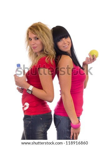 Two attractive fitness girl - stock photo