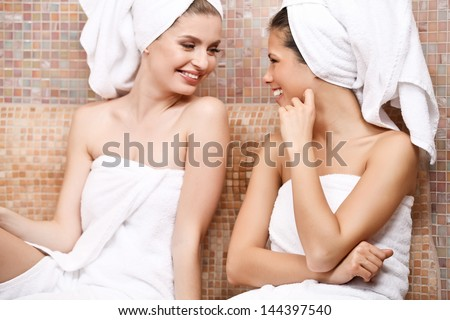 Two attractive girl friends in Turkish sauna - stock photo