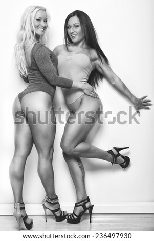 Two attractive girls with slim bodies - stock photo