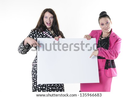 Two attractive plus-size models to wear flashy costumes and presenting a blank billboard, isolated against white background.