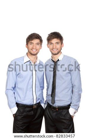 Two attractive positive smile young business people standing, dressed in shirt, tie. Concept Success, isolated over white background