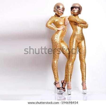 Two attractive sexy girls posing in fetish wear. More outfits in photo set - stock photo