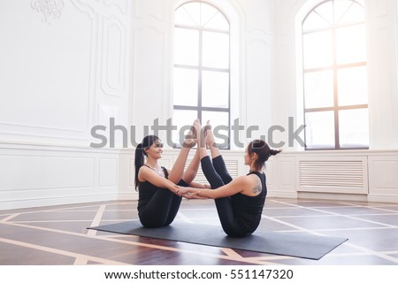 two attractive sport girls work out stock photo 551561536