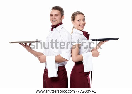 Two attractive waiters on a white background