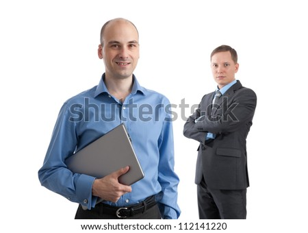 Two attractive young businesspeople smiling at the camera isolated on white background - stock photo