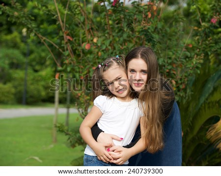 Two attractive young teen girl together portrait outdoor - stock photo