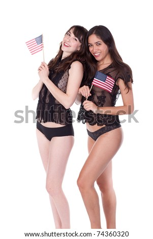Two attractive young women, dressed in lingerie, holding small American flags.