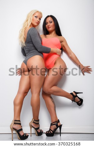 Two awesome women in pink and black underwear. - stock photo