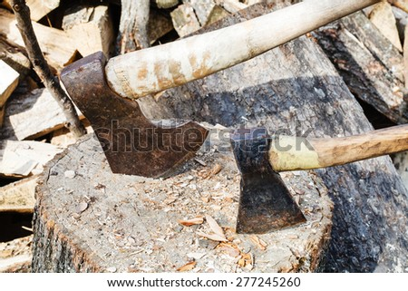 two axes in block for chopping firewood close up