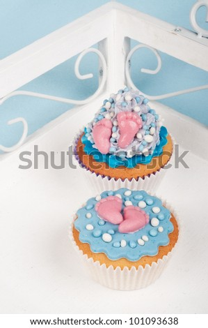 Two baby blue baby shower cupcakes - stock photo