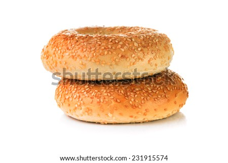 Two Bagels with sesame seeds on white background - stock photo