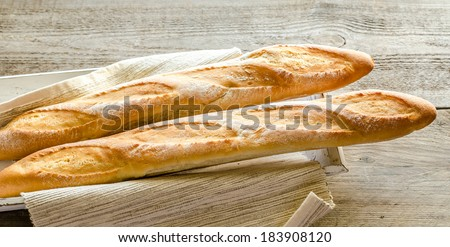 Two baguettes on the wooden tray - stock photo