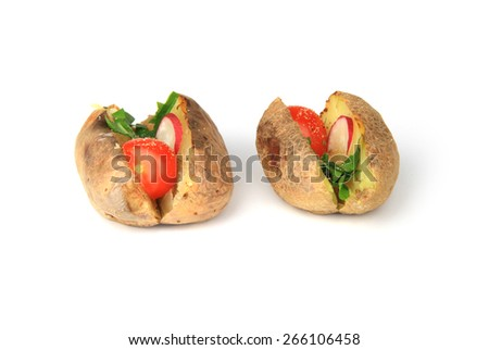 Two baked potatoes filled with vegetables, butter and spices on white background. - stock photo