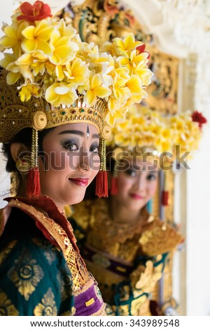 two Balinese Legong dancers at decorative window - stock photo
