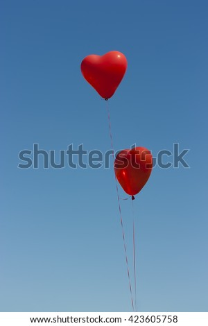 Two balloons in the form of a symbol of love hearts