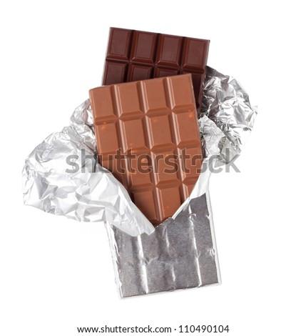 Two bars of chocolate. Dark chocolate and milk chocolate with nuts. - stock photo