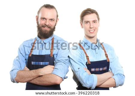 two bartender with a shaker and bottle on white background. behind the bar - stock photo