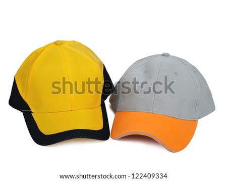 two baseball caps isolated on white background - stock photo