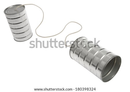 Two basic tin cans with rope attached to communicate, white background