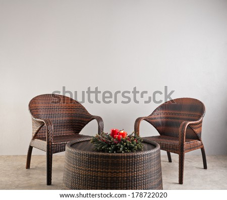 Two basket weaved chairs with advent flower wreath - stock photo
