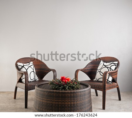 Two basket weaved seater in a lounge   - stock photo