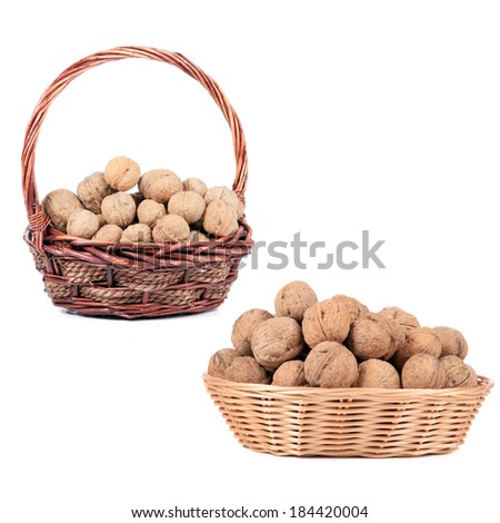Two basket with walnuts. Isolated on a white background.