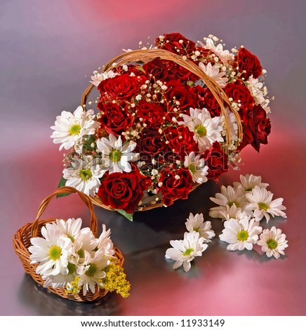 two baskets with red roses an margueritas - stock photo