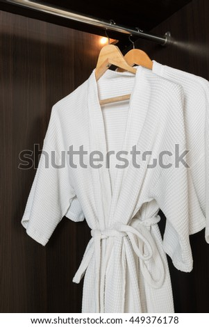 Two bathrobes hanger in the wardrobe for hotel or healthy spa