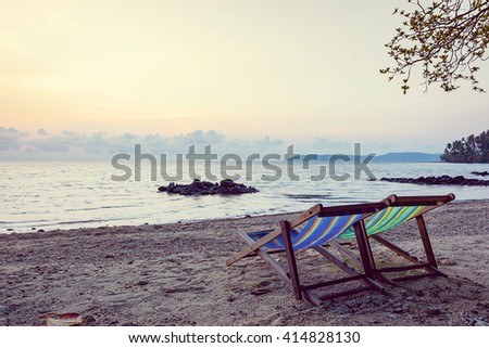 Two beach chairs at sunset