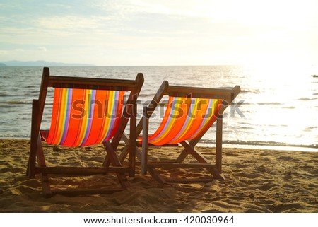 Two Beach Chairs at sunset light