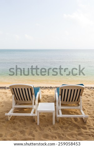 Two beach chairs at the empty Maenam Beach in Koh Samui, Thailand