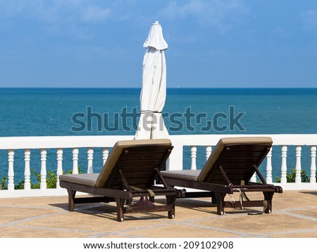 Two beach chairs on the beach in Pattaya, Thailand - stock photo