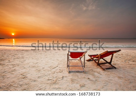 Two Beach Chairs over the Sunset