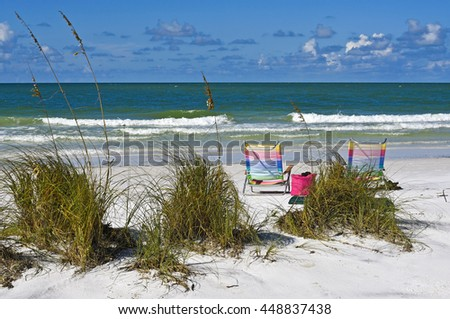 Two Beach Chairs with Beach Bag on the Beach - stock photo