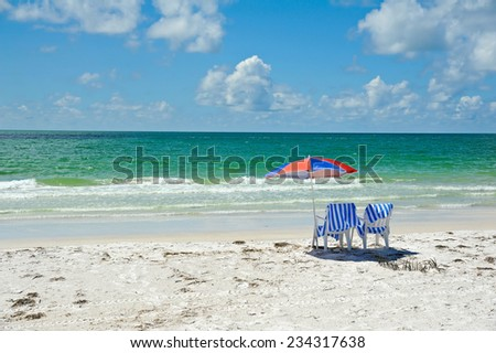Two Beach Chairs with Umbrella on the Beach