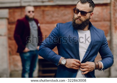 Two bearded men fashion outdoors
