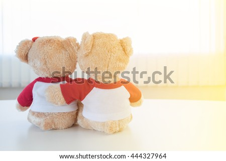 two bears toy holding together, friendship, love and care concept  - stock photo