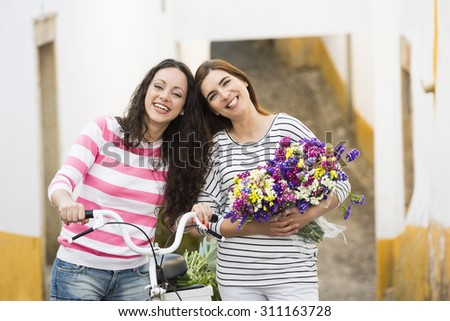Two beautiful and happy friends smiling - stock photo