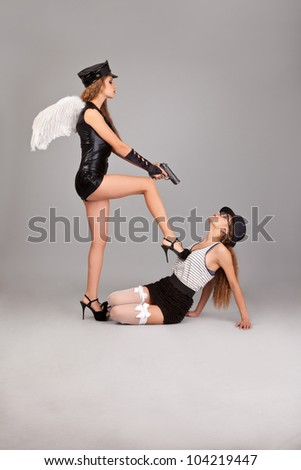 Two beautiful and sexy girls isolated on grey background
