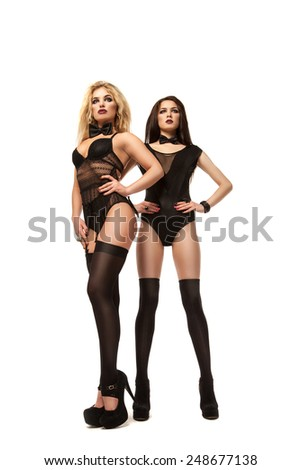 Two beautiful and sexy woman in black lingerie on a white background