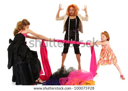 Two beautiful angry spoiled pageant girls fighting over fabric for dress design over white. - stock photo